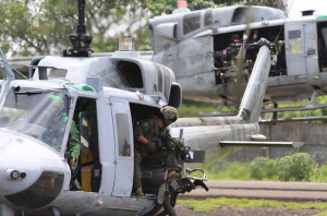 US Huey Heli Crew takes off from Santa Elena, Peten as part of Op Martillo. Photo: US Southcom.